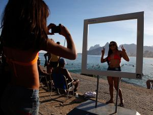 RIO DE JANEIRO, BRAZIL - JUNE 08: A beachgoer poses for a photo at a suggested Instagram spot on Ipanema Beach as the 2014 FIFA World Cup nears on June 8, 2014 in Rio de Janeiro, Brazil. (Photo by Jamie Squire/Getty Images)