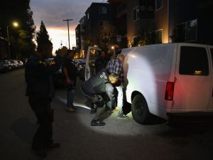 A man is detained by Immigration and Customs Enforcement (ICE) agents in Los Angeles, Calif.