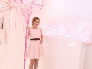 Lauren Conrad with a blush background.