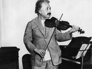 Albert Einstein as he plays a violin in the music room of the S.S. Belgenland en route to California, 1931.