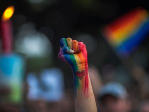 A defiant fist is raised at a vigil for the shooting at an Orlando gay nightclub on June 13, 2016.