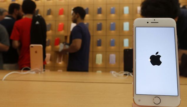 Customers gather at a US tech-giant Apple store during the launch of the new iPhones on September 17, 2016, at the Mall of the Emirates in Dubai. Apple's global iPhone launch was marked by excitement and frustration as fans queued to find scarce models of the coveted smartphone. / AFP / KARIM SAHIB (Photo credit should read KARIM SAHIB/AFP/Getty Images)