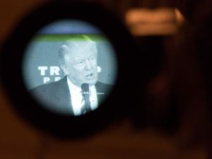 Donald Trump is seen through a TV camera eyepiece as he speaks at a private gathering in 2016.