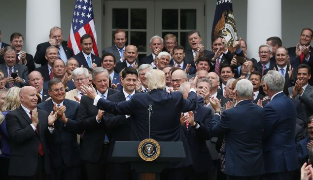 President Donald Trump congratulates House Republicans after they passed legislation aimed at repealing the Affordable Care Act during an event at the White House on May 4, 2017.