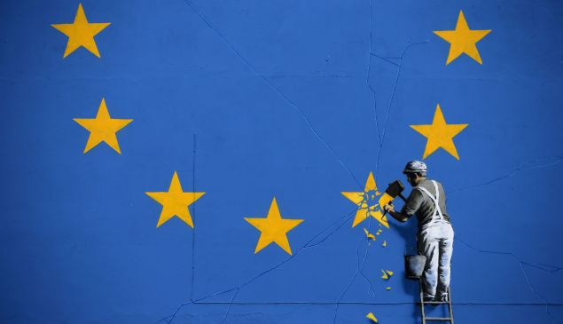 A recently painted mural by British graffiti artist Banksy, depicting a workman chipping away at one of the stars on a European Union (EU) themed flag, is pictured in Dover, south east England on May 8, 2017.