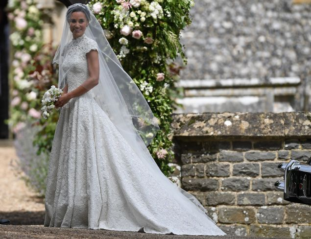 TOPSHOT - Pippa Middleton, sister of Britain's Catherine, Duchess of Cambridge, arrives for her wedding to James Matthews at St Mark's Church in Englefield, west of London, on May 20, 2017. Pippa Middleton hit the headlines with a figure-hugging outfit at her sister Kate's wedding to Prince William but now the world-famous bridesmaid is becoming a bride herself. Once again, all eyes will be on her dress as the 33-year-old marries financier James Matthews on Saturday at a lavish society wedding where William and Kate's children will play starring roles. / AFP PHOTO / POOL / Justin TALLIS (Photo credit should read JUSTIN TALLIS/AFP/Getty Images)