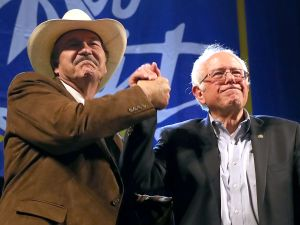 Congressional candidate Rob Quist and Sen. Bernie Sanders greet supporters during a campaign rally on May 20, 2017 in Butte, Mont.