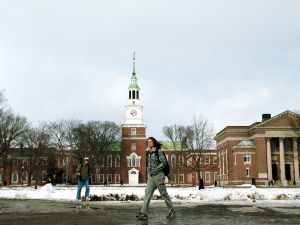 A Dartmouth College student walks across the main campus.
