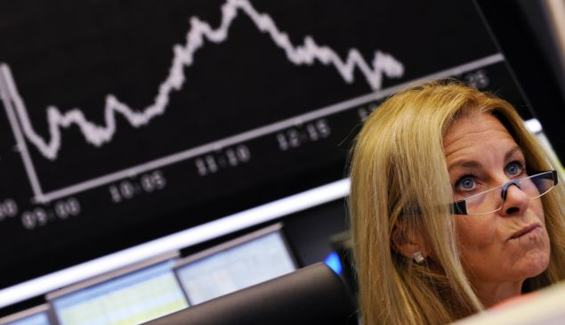 A stock broker looks at her screen in September 2008, the day before after US investment bank Lehman Brothers filed for bankruptcy protection.