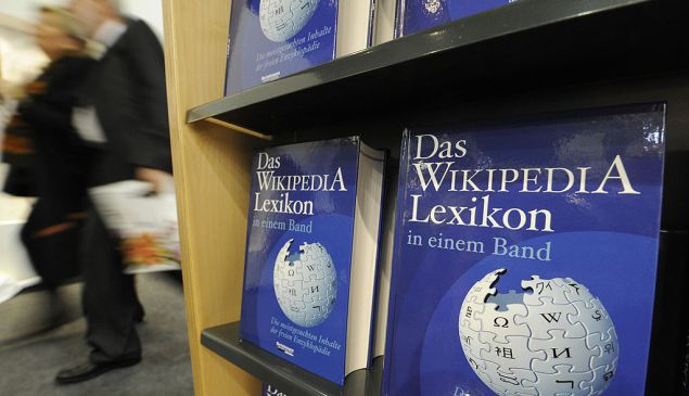 """Copies of the """"One-Volume Wikipedia Encyclopaedia"""" are on display at the Frankfurt Book Fair on October 16, 2008. The volume is made up of 50,000 of the most-searched terms on the German language edition of Wikipedia, and represents the first print version of the now-famous online encyclopaedia. Turkey is guest of honour at the 60th edition of the book fair, which takes place from October 15 to 19, 2008. AFP PHOTO / JOHN MACDOUGALL (Photo credit should read JOHN MACDOUGALL/AFP/Getty Images)"""