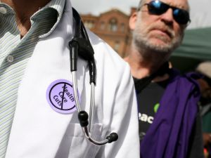A doctor protests during a rally outside of San Francisco General Hospital.