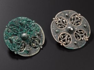 Two disc brooches.