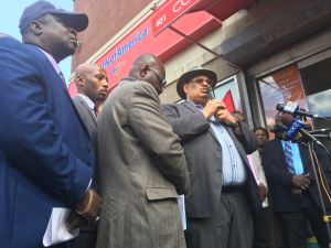 African community leaders hold a rally at the corner of 149th Street and 3rd Avenue in the Bronx to support a Burkinabe street vendor beaten unconscious by a group of men.