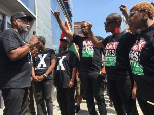 "Roughly 100 people marched along 125th Street in Harlem in a Malcolm X Day ""Black Power March."""