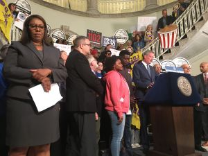 "Elected officials and workers celebrate the passage of ""Fair Work Week"" package of bills in the City Hall Rotunda."