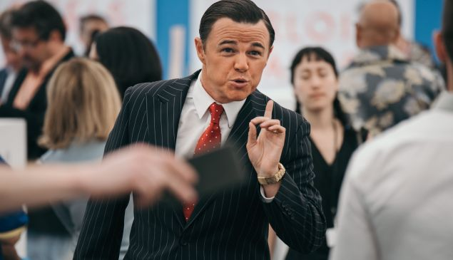 Jordan Belfort ala The Wolf of Wall Street Leo berating fairgoers for Dora Budor's performance MANICOMIO!, 2017.