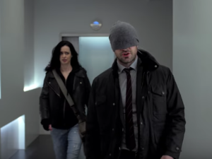 Krysten Ritter as Jessica Jones and Charlie Cox as Matt Murdock.