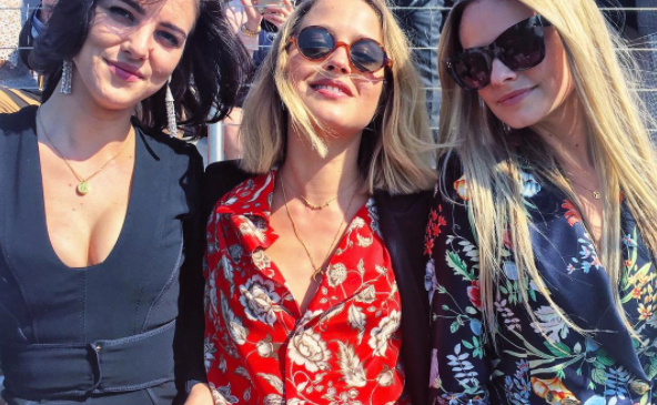 Tess Ward is in the middle, wearing a familiar Gucci blouse.