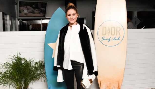 Olivia Palermo paddles into the Dior Surf Club.
