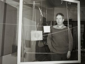 Calder with the frame for Snake and the Cross (1936) in his New York City storefront studio, winter 1936.