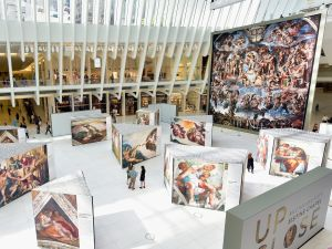 The show features near life-size reproductions of Michelangelo's word famous frescoes.