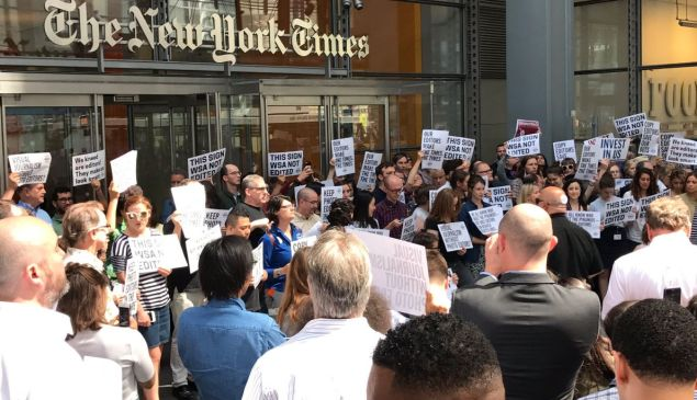 New York Times staff protest planned copy team cuts.