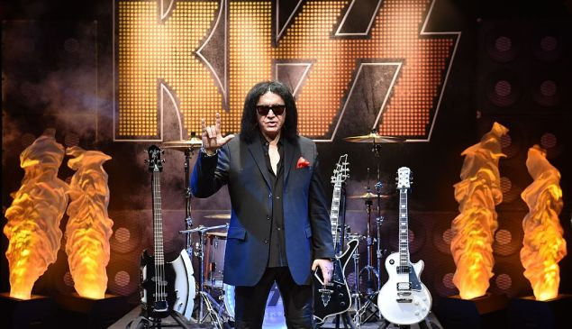 Musician Gene Simmons of KISS raising his hand in the gesture he's trying to trademark.