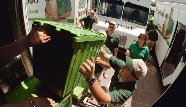 Several Peapod workers unload containers of groceries from the back of their truck July 12, 2000 in Chicago. Peapod, an online grocery supermarket, plans to upgrade their web site with new technology to improve services, the company told shareholders. (Photo by Tim Boyle/Getty Images)