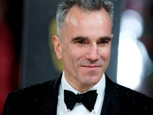 Daniel Day-Lewis poses on the red carpet upon arrival to attend the annual BAFTA British Academy Film Awards in 2013.