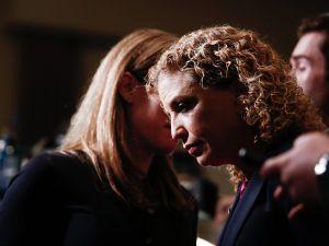 Congresswoman Debbie Wasserman Schultz talks to an aide.