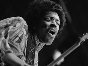 Rock guitar virtuoso Jimi Hendrix (1942 - 1970) caught mid guitar-break during his performance at the Isle of Wight Festival, August 1970.