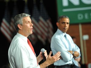 Former U.S. Department of Education Secretary Arne Duncan with ex-President Barack Obama.