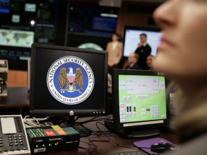 The National Security Agency (NSA) logo is shown on a computer screen inside the Threat Operations Center at the NSA in Fort Meade. U.S. President George W. Bush visited the ultra-secret National Security Agency on Wednesday to underscore the importance of his controversial order authorizing domestic surveillance without warrants.