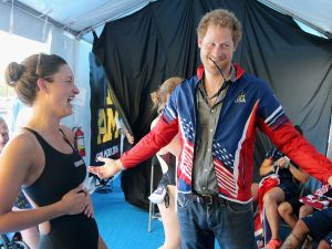 ORLANDO, FL - MAY 11: Prince Harry tries on USA Invictus Team Member Elizabeth Marks's Team USA jersey in the competitor's tent at the swimming pool during the Invictus Games Orlando 2016 at ESPN Wide World of Sports on May 11, 2016 in Orlando, Florida. Prince Harry, patron of the Invictus Games Foundation is in Orlando for the Invictus Games 2016. The Invictus Games is the only International sporting event for wounded, injured and sick servicemen and women. Started in 2014 by Prince Harry the Invictus Games uses the power of Sport to inspire recovery and support rehabilitation. (Photo by Chris