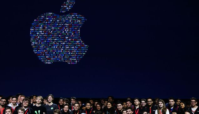 People gathered together to take a group photo with Apple's logo at Apple's annual Worldwide Developers Conference at the Bill Graham Civic Auditorium in San Francisco, California, on June 13, 2016. / AFP / GABRIELLE LURIE (Photo credit should read GABRIELLE LURIE/AFP/Getty Images)