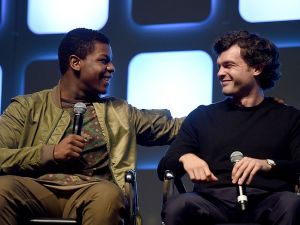 John Boyega (L) and Alden Ehrenreich, who will play Han Solo, on stage at a Star Wars event.