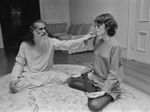 American author Prudence Farrow, the sister of actress Mia Farrow, receives yoga training from the Swami Satchidananda (1914 - 2002), 24th November 1967. Farrow was the inspiration for the Beatles song 'Dear Prudence'
