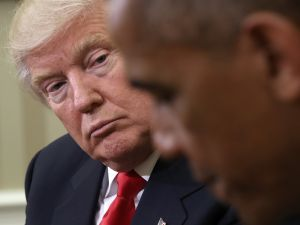 Former President Barack Obama speaks while meeting with President Donald Trump.