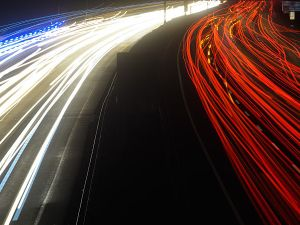Picture taken with long time exposure shows light traces of cars driving on the A2 highway at the connection 'Lehrte' near Hanover, central Germany, on January 17, 2017. / AFP / dpa / Julian Stratenschulte / Germany OUT (Photo credit should read JULIAN STRATENSCHULTE/AFP/Getty Images)