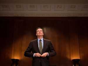 FBI Director James Comey prepares to testify about Target-wear.