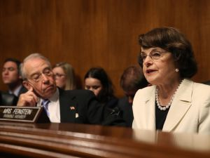 Sen. Dianne Feinstein speaks while Sen. Chuck Grassley sits nearby during a Senate Judiciary Committee hearing.