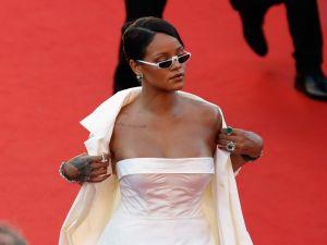 Rihanna throws shade in her tiny shades.