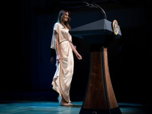 Melania Trump goes for the gold in a Monique Lhuillier frock.