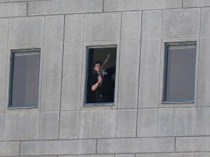 An Iranian policeman holds a weapon as he stands by a window at the Iranian parliament on June 7, 2017 during an attack on the complex.