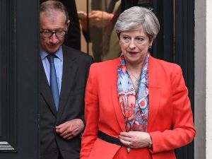 LONDON, ENGLAND - JUNE 09: British Prime Minister Theresa May leaves Conservative Party Headquaters with her husband Philip on June 9, 2017 in London, England. After a snap election was called the United Kingdom went to the polls yesterday, in a closely fought election the results from across the country are being counted and an overall result is expected in the early hours.