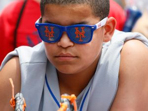 ATLANTA, GA - JUNE 11: A young NY Mets fan prior to the MLB game between the Atlanta Braves and the New York Mets on Sunday, June 11, 2017 at SunTrust Park in Atlanta, GA.
