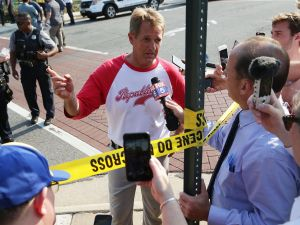 Sen. Jeff Flake briefs members of the media near where a shooting took place on June 14, 2017 in Alexandria, Va. House Majority Whip Rep. Steve Scalise and multiple congressional aides were shot by a gunman during a Republican baseball practice.