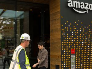 People walk past the Amazon Go grocery store at the Amazon corporate headquarters on June 16, 2017 in Seattle, Washington.