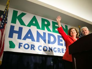 Republican candidate for Georgia's Sixth District congressional seat Karen Handel declares victory with her husband Steve.