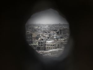 MOSUL, IRAQ - JUNE 22: A view of Mosul's Old City through an Iraqi forces sniper hole in the wall of a frontline position in Adedat, a neighbourhood in the Old City of west Mosul, the last area of the city under Islamic State control, June 22, 2017. Iraqi forces have encountered stiff resistance with improvised explosives, car bombs, heavy mortar fire and snipers hampering their advance. (Photo by Martyn Aim/Getty Images)